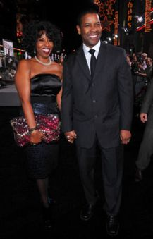 """HOLLYWOOD - JANUARY 11: Actor/producer Denzel Washington (R) and wife Pauletta Washington (L) arrive at the premiere of Warner Bros. """"The Book Of Eli"""" held at Grauman's Chinese Theatre on January 11, 2010 in Hollywood, California. (Photo by Alberto E. Rodriguez/Getty Images)"""